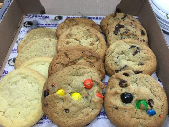 From top left to right: A selection of snickerdoodle, peanut butter chip, chocolate chunk, sugar and M&M cookies from Insomnia Cookies in St. Cloud.