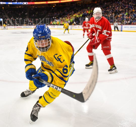 Cathedral's Cullen Hiltner works along the boards during the Minnesota Boys Hockey Tournament Class A quarterfinals Wednesday, March 6, at the Xcel Energy Center in St. Paul.