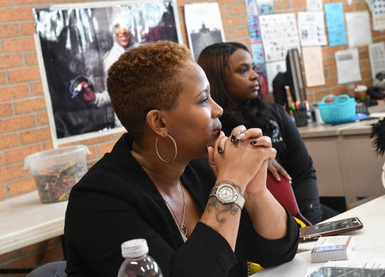 KoriAnn Carter and Talishia Barlow work with girls in the GOATS, Girls On Arise To Succeed, program Wednesday, Feb. 27, at Roosevelt Boys & Girls Club in St. Cloud.