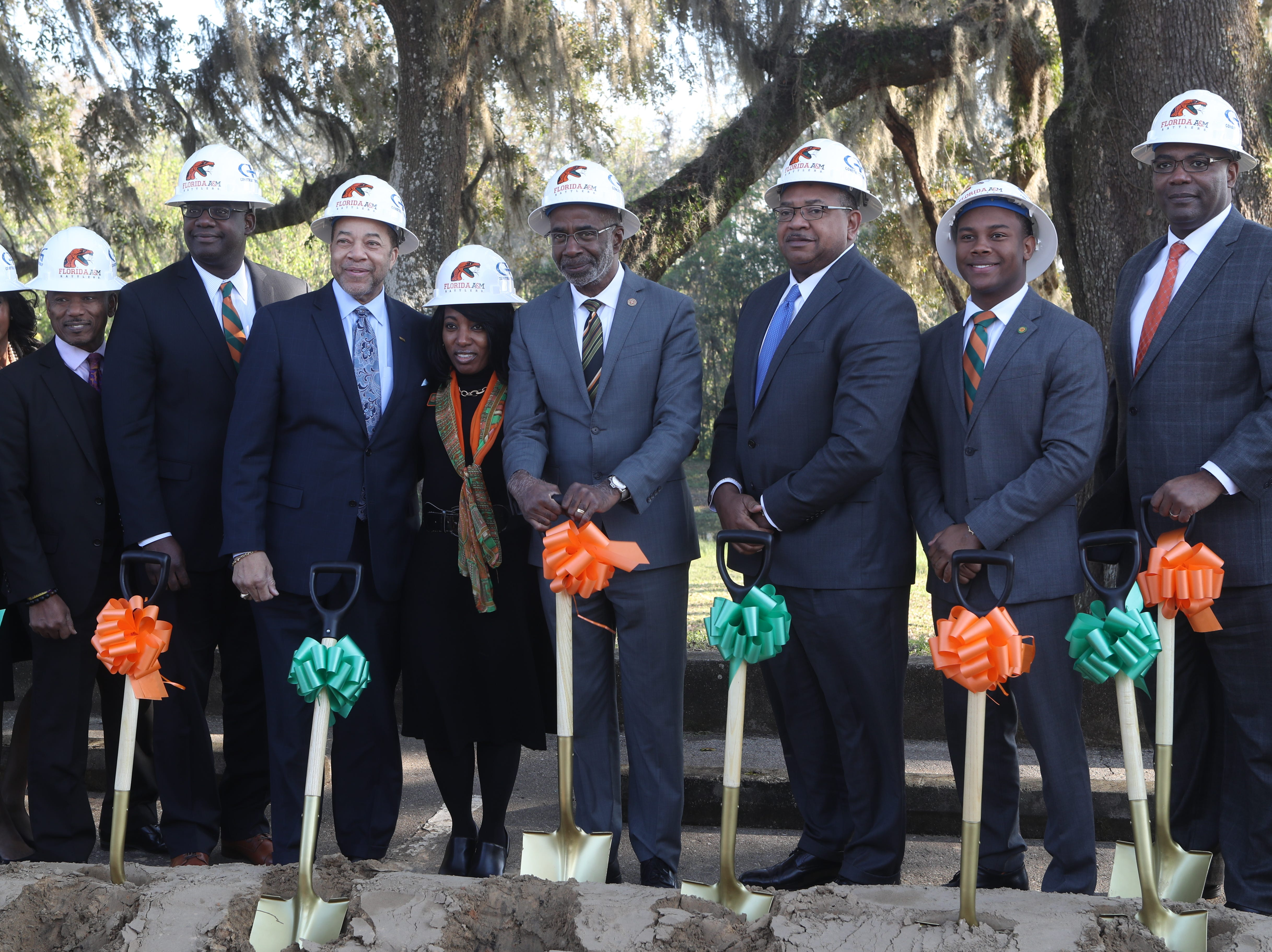 Ceremonial groundbreaking participants pose with their shovels during a groundbreaking celebration for a new residence hall on the Florida A&M campus Wednesday, March 6, 2019.