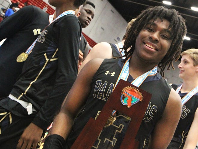 Tyreke McElwain celebrates after St. John Paul II's boys basketball team celebrates a 50-48 overtime victory against Orlando Christian Prep to capture a Class 3A state championship at the RP Funding Center in Lakeland on Tuesday.