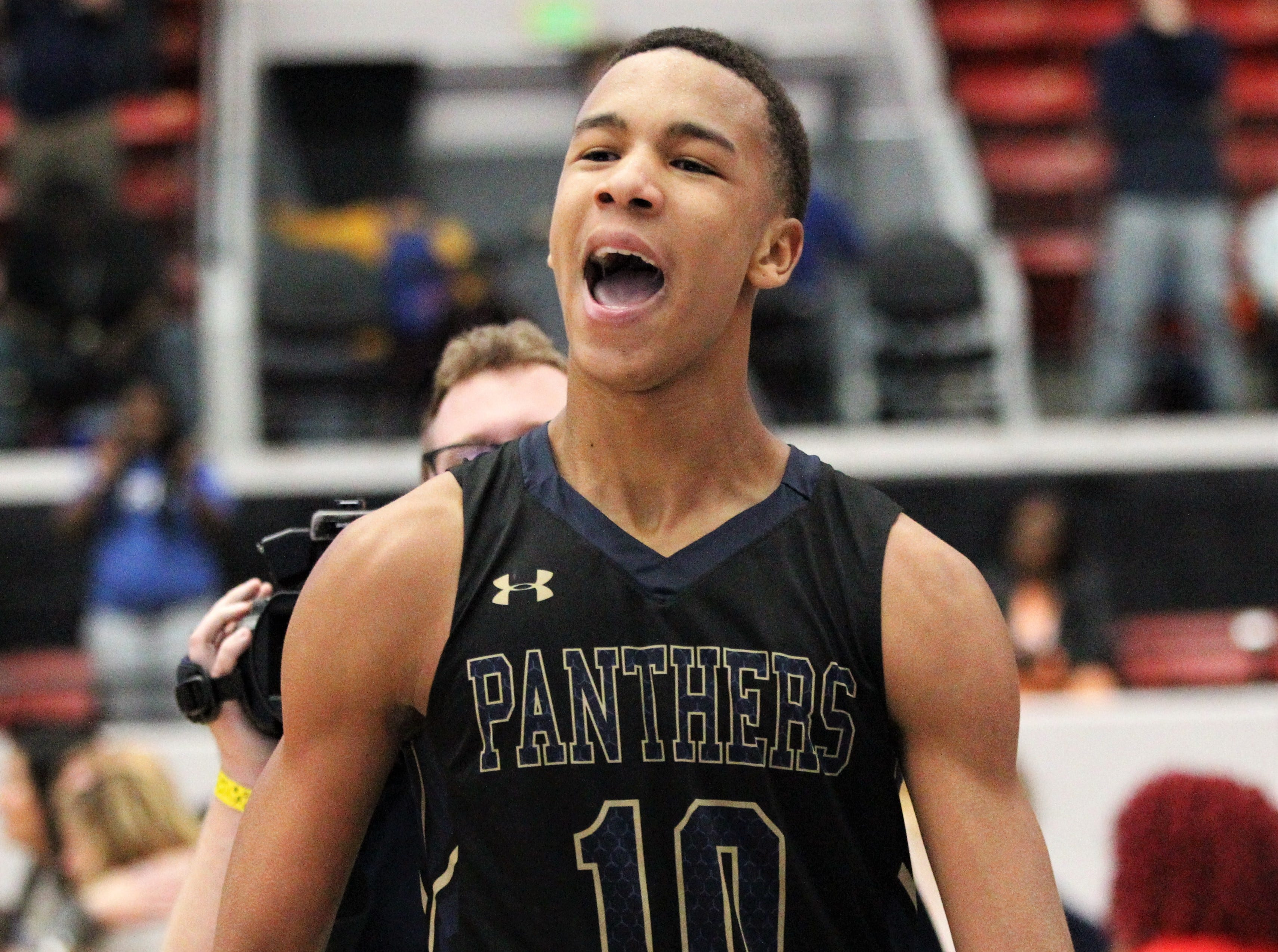 St. John Paul II's Allan Jeanne-Rose screams as the Panthers' boys basketball team celebrates a 50-48 overtime victory against Orlando Christian Prep to capture a Class 3A state championship at the RP Funding Center in Lakeland on Tuesday.