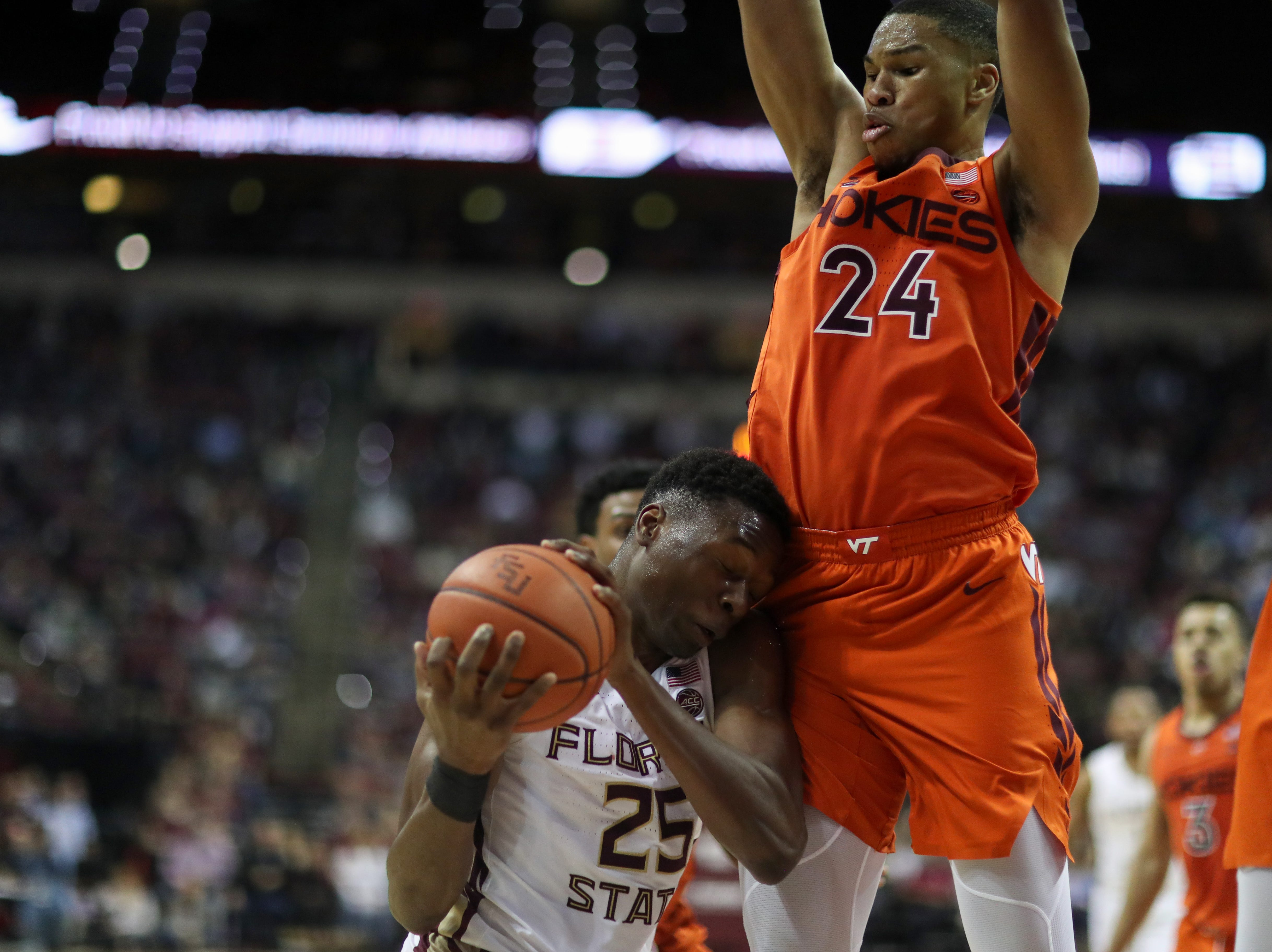 Florida State Seminoles forward Mfiondu Kabengele (25) meets the body of a defender on his way up to the hoop during a game between FSU and Virginia Tech at the Donald L. Tucker Civic Center Tuesday, March 5, 2019.