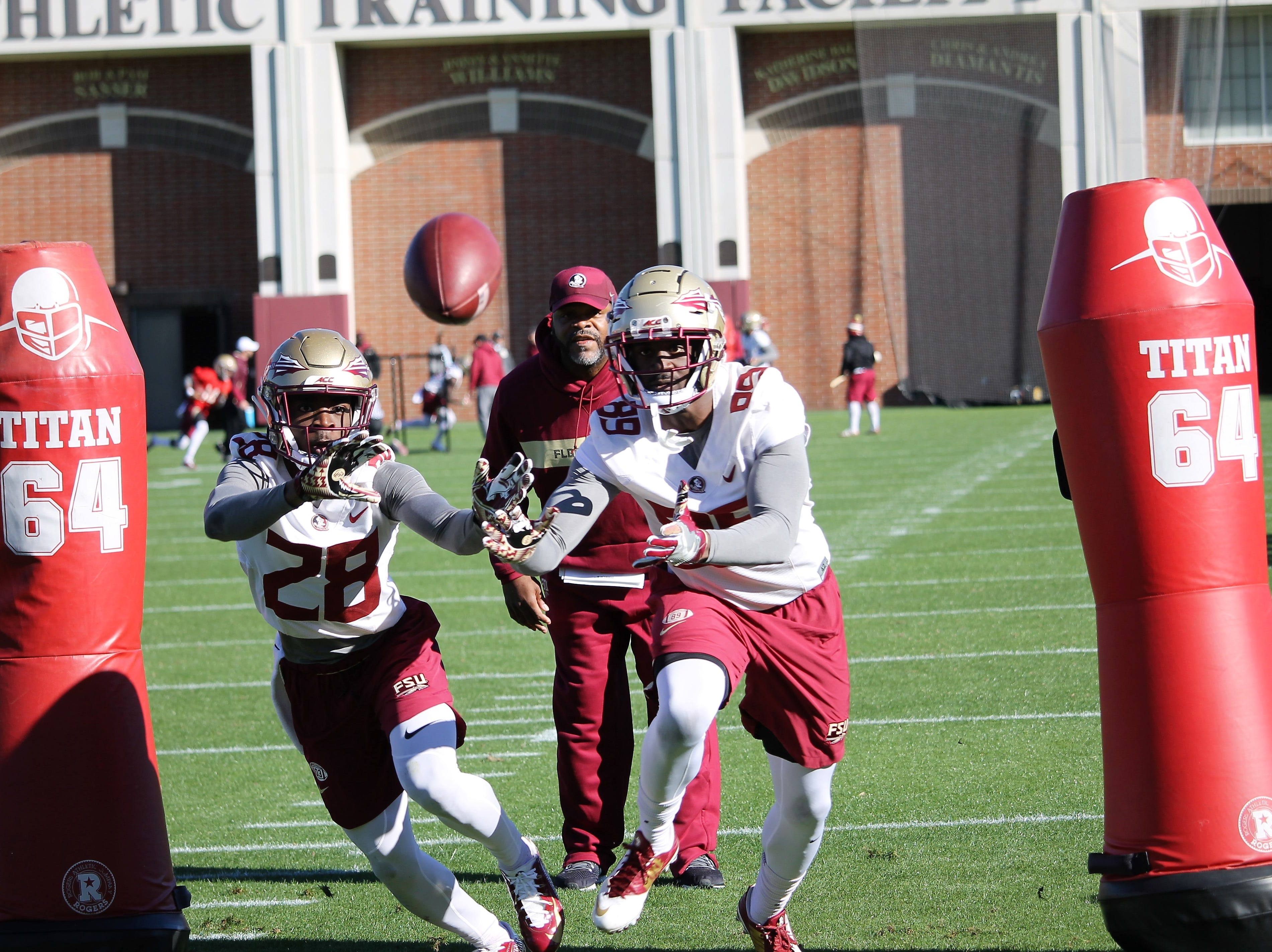 Wide receivers D'Marcus Adams (28) and Keith Gavin (89) at FSU football practice on March 6, 2019.