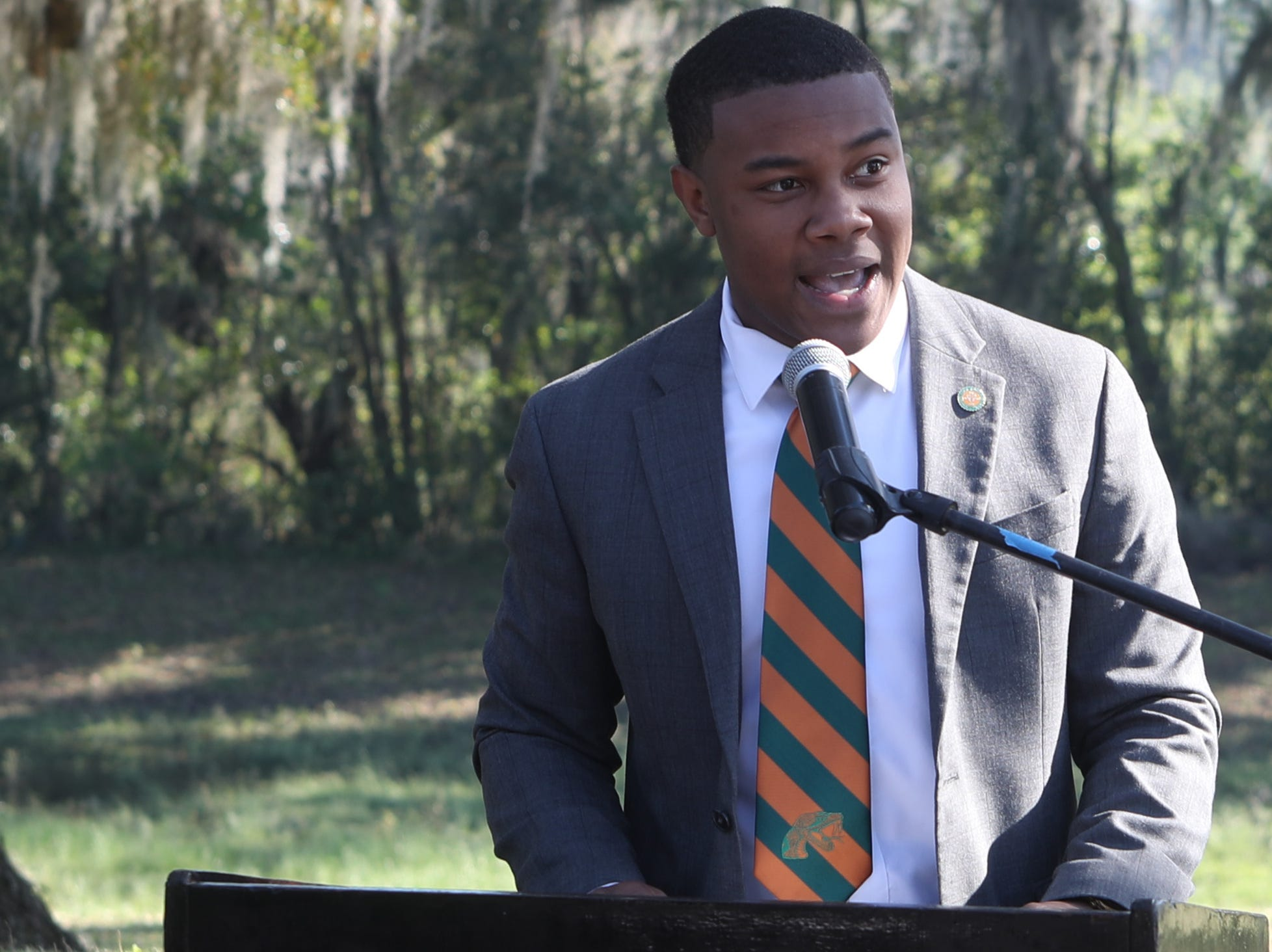 Trustee and President of the Florida A&M Student Government Association David Jackson III speaks during a groundbreaking celebration for a new residence hall on the Florida A&M campus Wednesday, March 6, 2019.