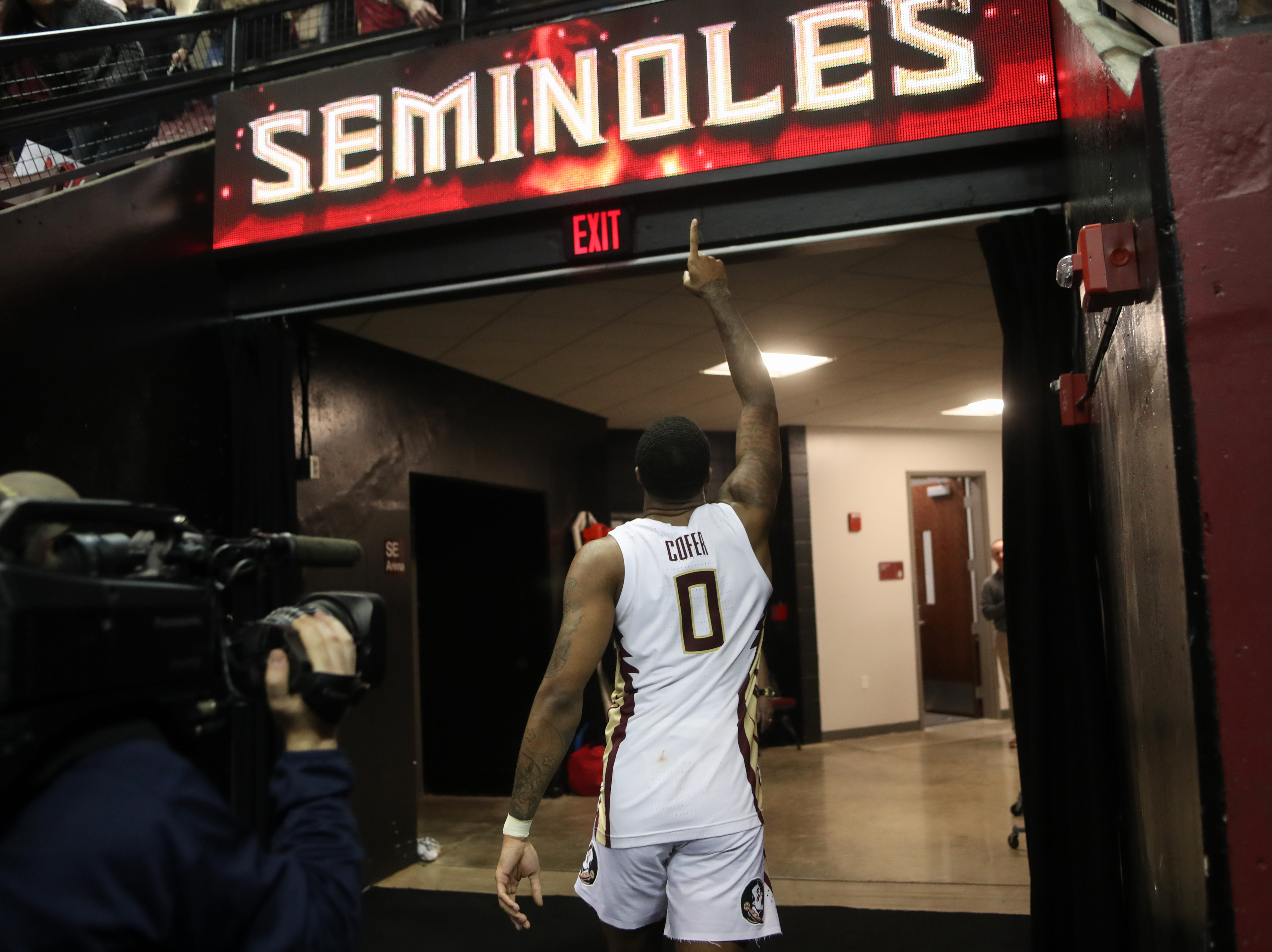 Florida State Seminoles forward Phil Cofer (0) gives one last goodbye to the fans before returning to the locker room after the team defeated Virginia Tech at the Donald L. Tucker Civic Center Tuesday, March 5, 2019.