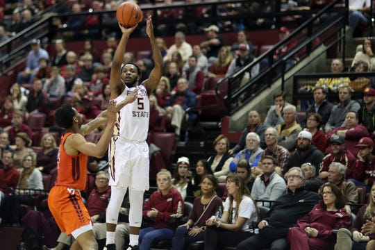 Florida State Seminoles guard PJ Savoy (5) shoots a three during a game between FSU and Virginia Tech at the Donald L. Tucker Civic Center Tuesday, March 5, 2019.