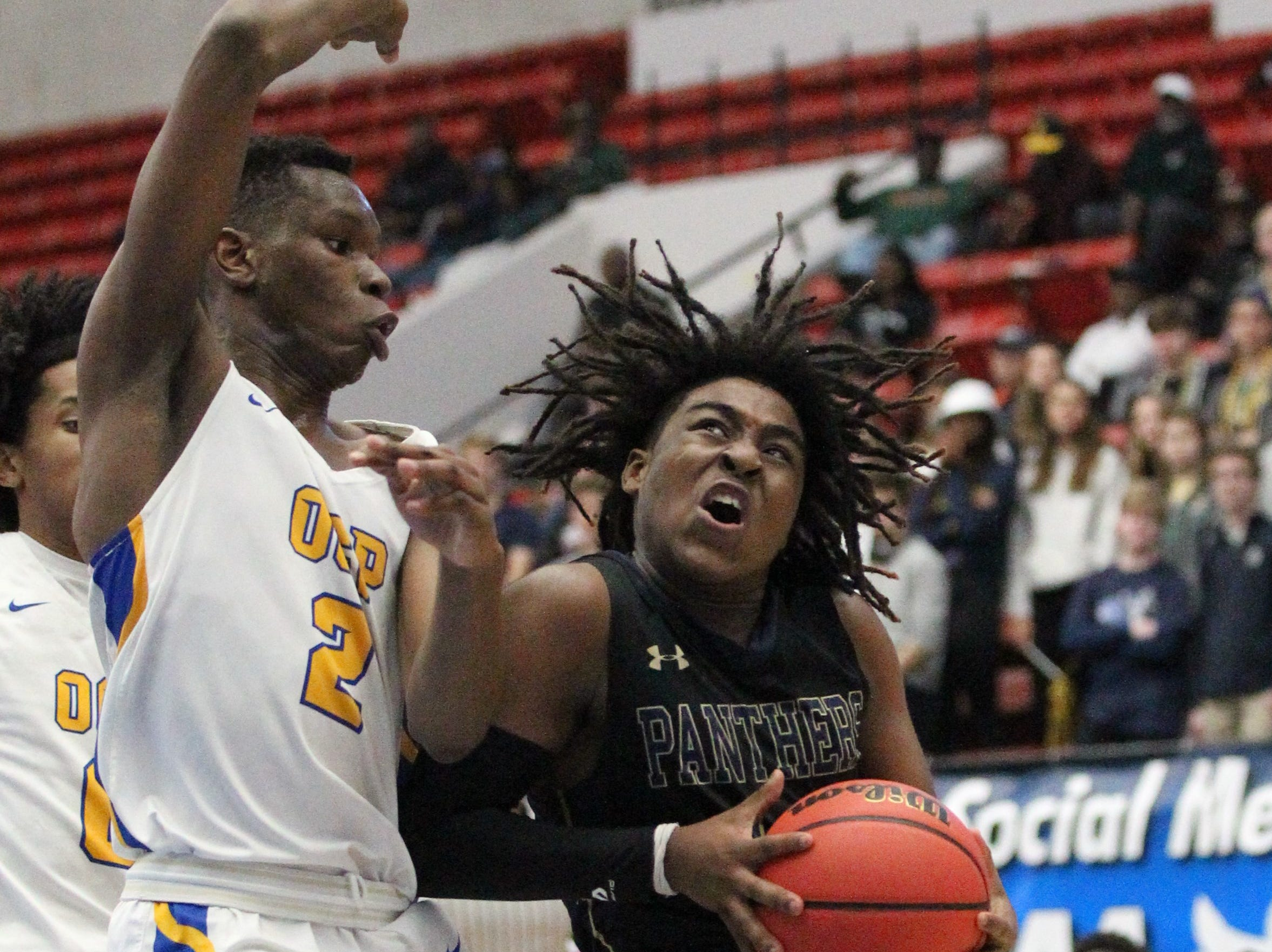St. John Paul II's boys basketball team captured a Class 3A state championship with a 50-48 overtime victory against Orlando Christian Prep on Tuesday at the RP Funding Center in Lakeland.