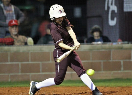Madison County senior catcher Amber Reed laces an RBI hit during a big inning of a blowout win over Suwannee.