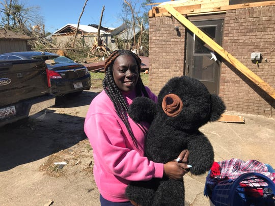 Gail Sanders holds onto a Teddy bear her husband Raymond Miller won for her at the fair in Tallahassee in the late 1990s. It's one of the few family possessions spared when a tornado hit their home in Cairo, Georgia, on March 3, 2019.