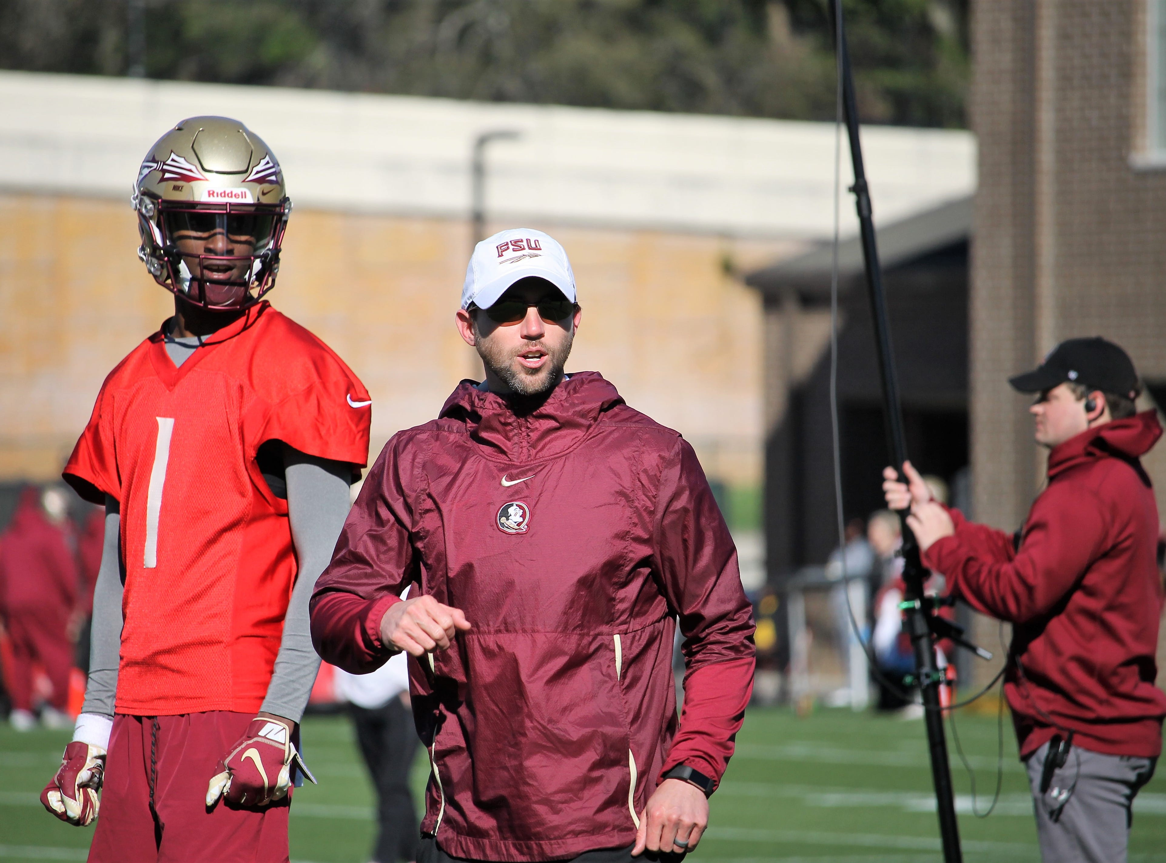 FSU QB James Blackman and offensive coordinator Kendal Briles at FSU football practice on March 6, 2019.