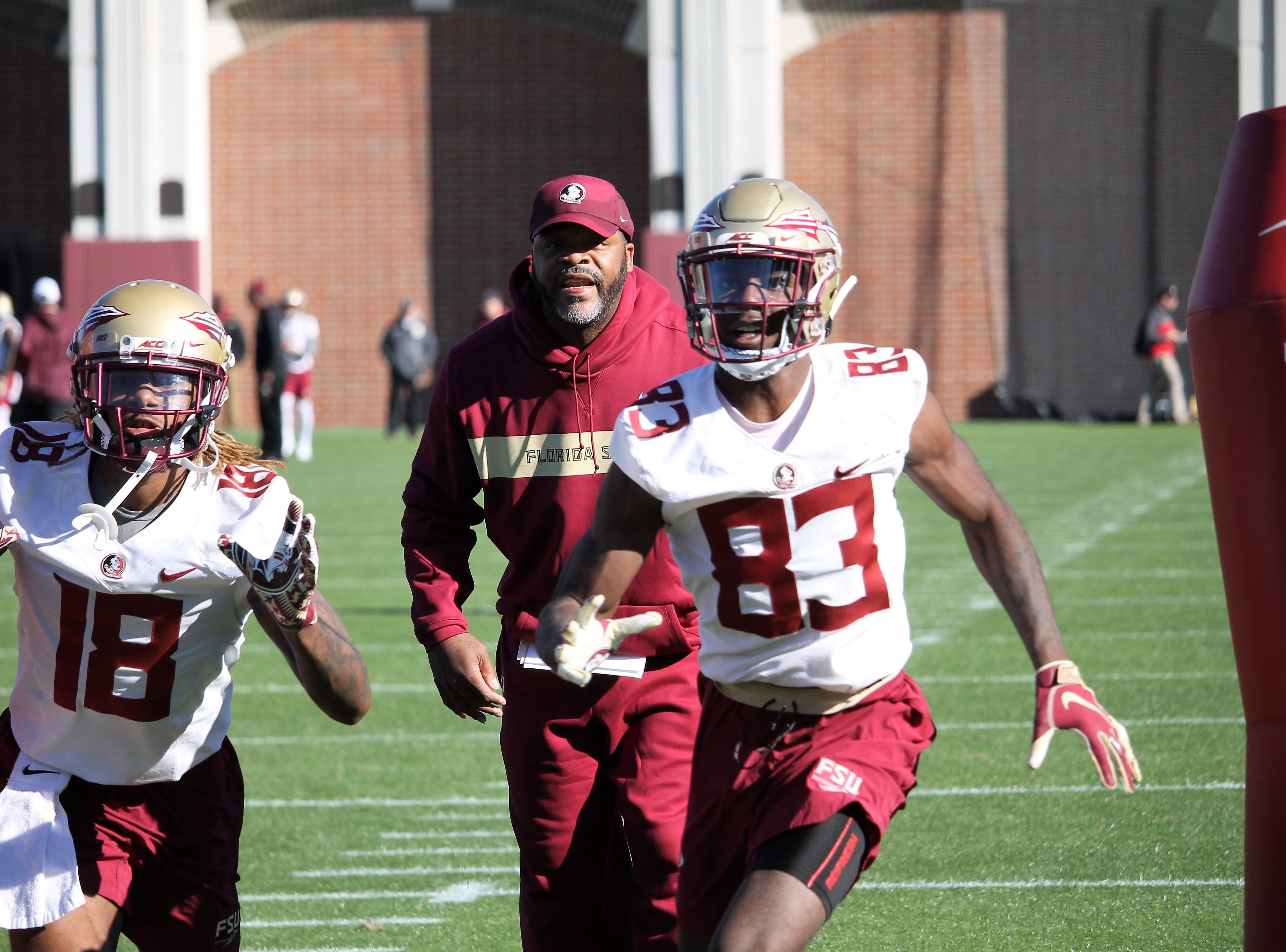 Wide receivers Warren Thompson (18) and Jordan Young (83) at FSU football practice on March 6, 2019.