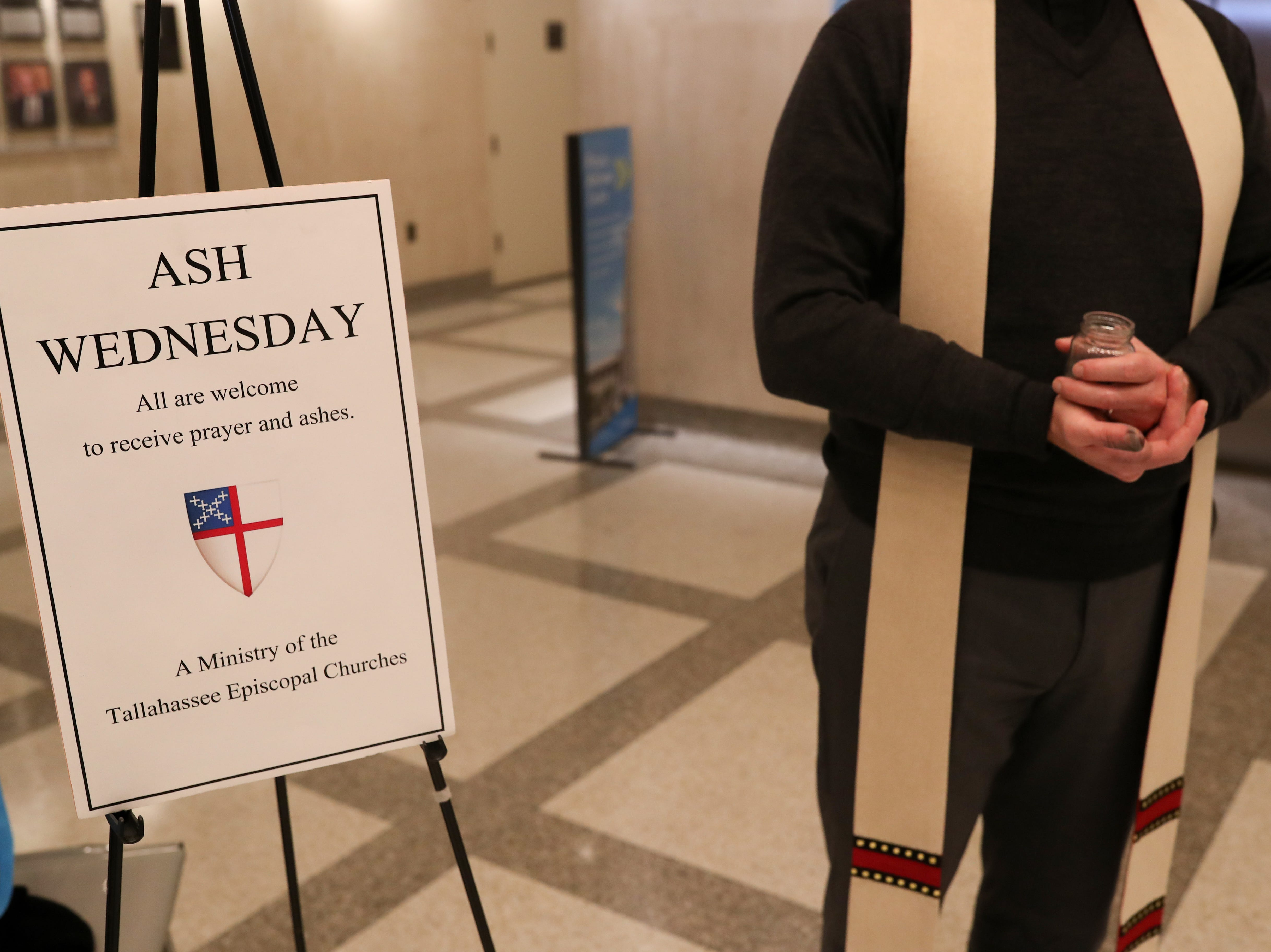 "Rev. David Killeen of St. John's Episcopal Church stands in the Florida Capitol rotunda waiting to place ashes on the foreheads of those wishing to save time by getting ""ashes to go"" during their busy Ash Wednesday, March 6, 2019."