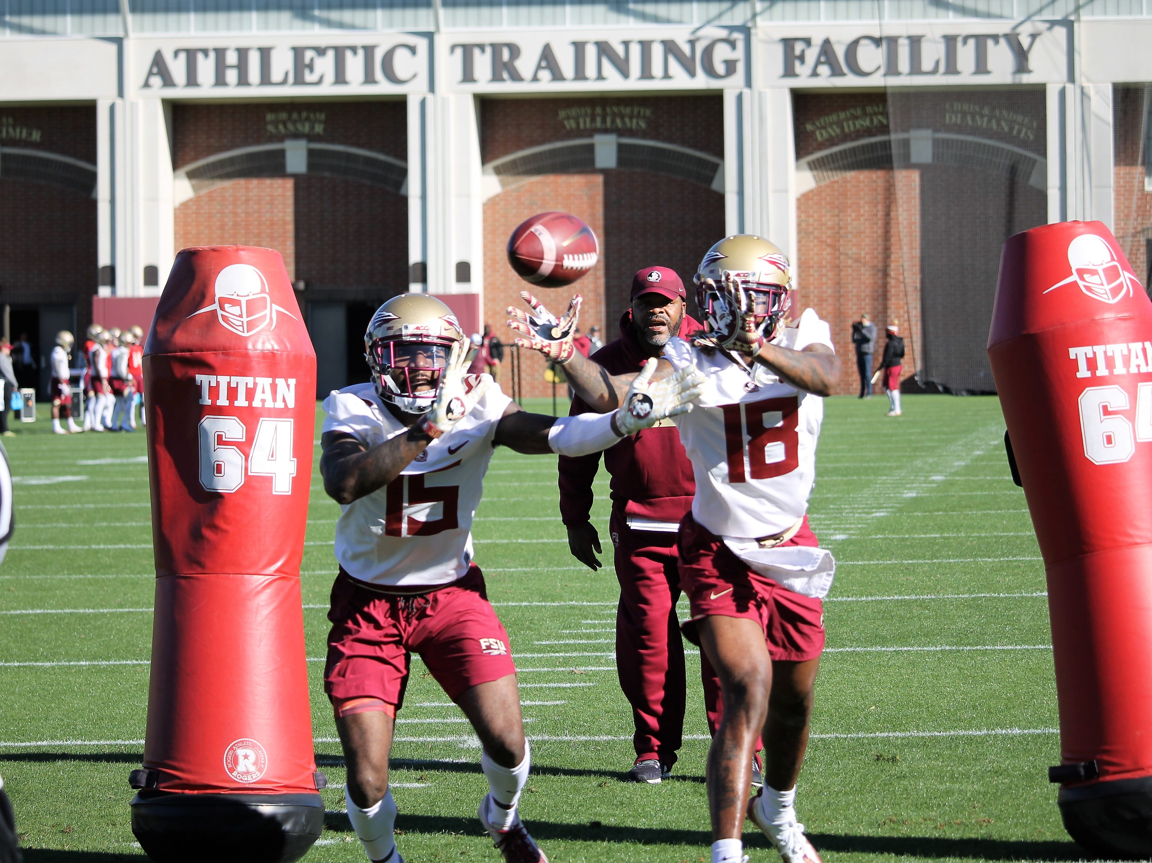 Wide receivers Tamorrion Terry (15) and Warren Thompson (18) at FSU football practice on March 6, 2019.