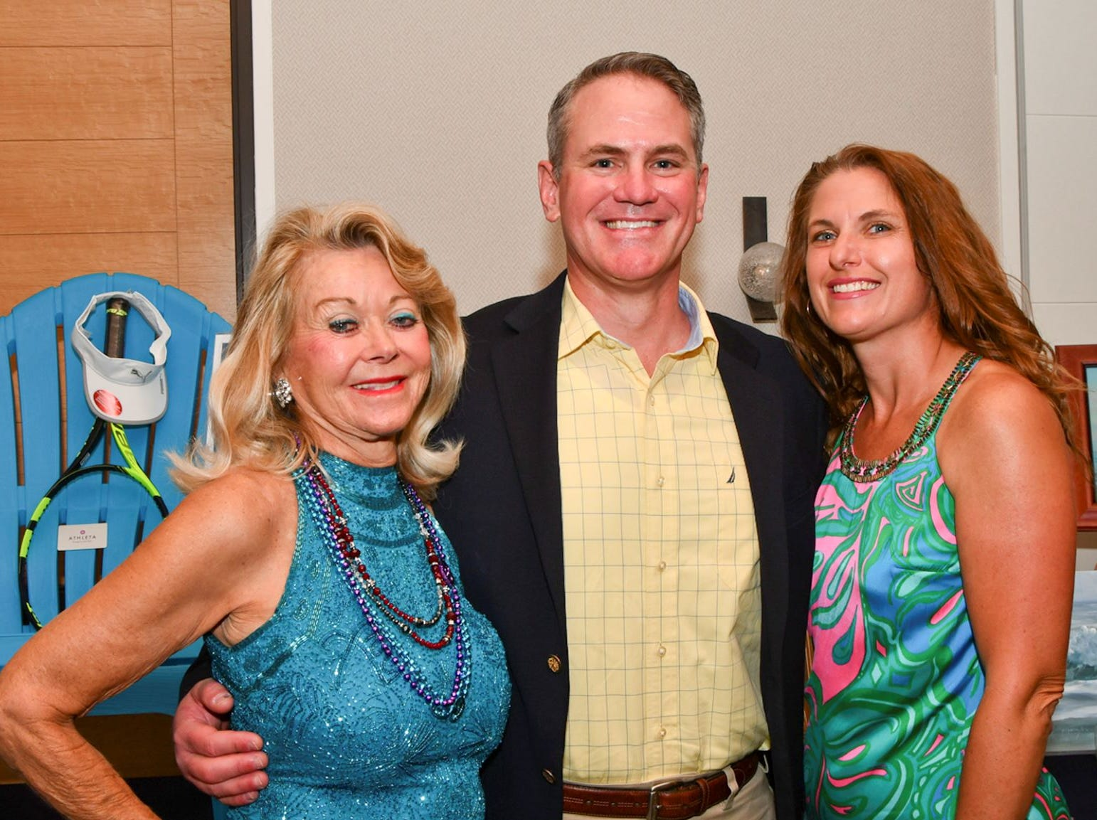 "Volunteer committee member Allola McGraw, left, and Matt and Susan King of Wilmington Trust at the ""Salty Dogs and Cat-A-Marans"" Paws & Claws Gala."