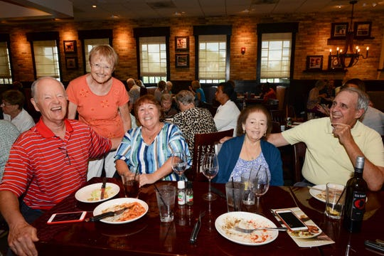 Bob and Kate Smith, left, Fran Miller, Elsie Batista and Ken Miller at Carrabba's Italian Grill in St. Lucie West for the Sarah's Kitchen luncheon.