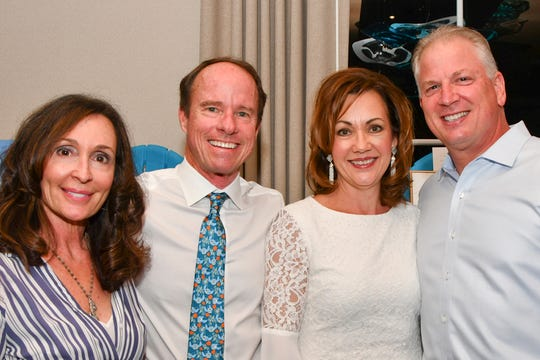 "Charleen and Jeff Sabin of Waste Management and Deanna and Jeff Atlas of Saelzer Atlas Wealth Management Group of Raymond James attend the ""Salty Dogs and Cat-A-Marans"" Paws & Claws Gala."