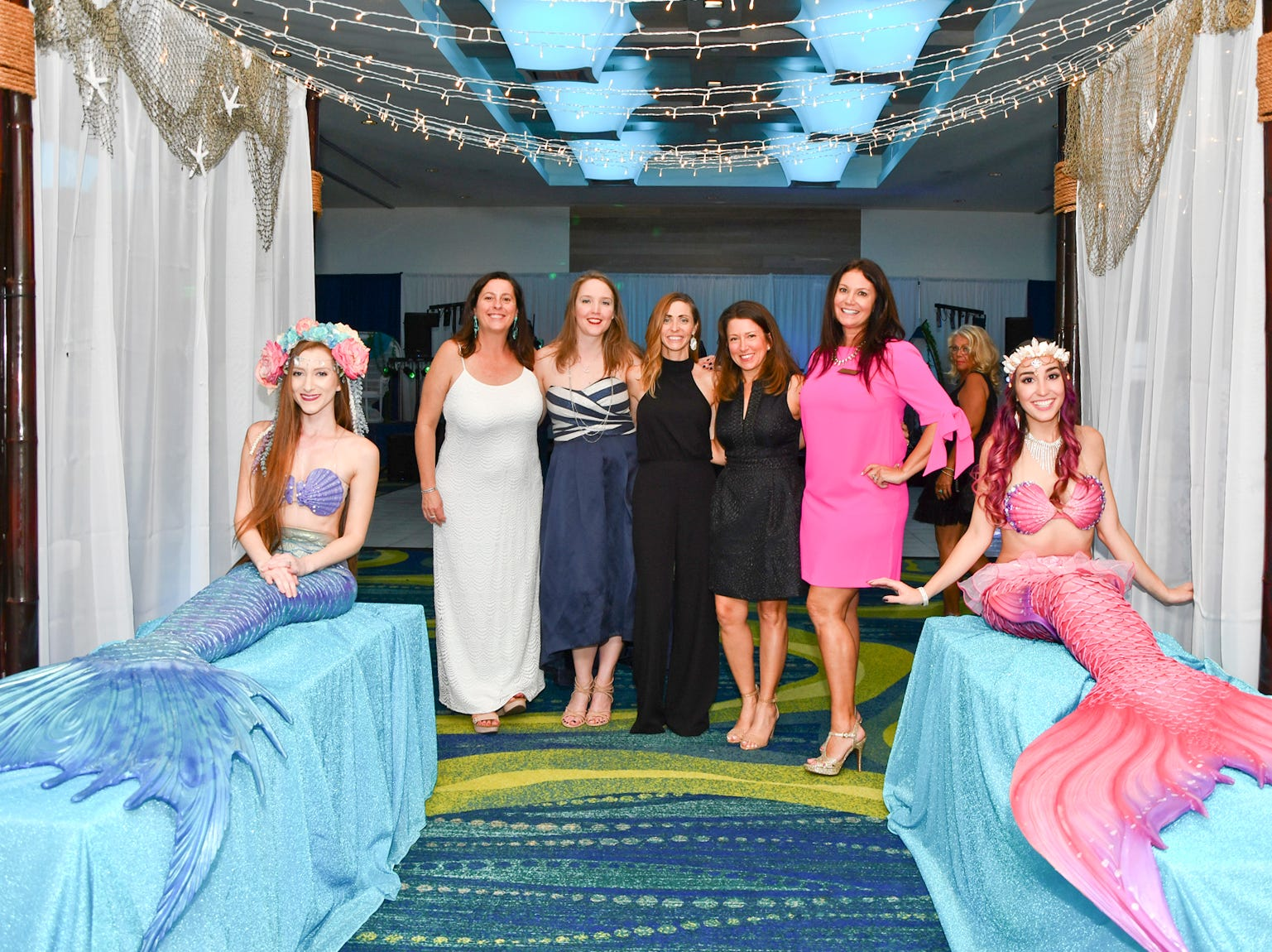 "Co-chair Jennifer Campbell, left, Sarah Ralicki, Susie Marsh, Victoria Padden and Co-chair Katie Astras pose with some mermaids at the ""Salty Dogs and Cat-A-Marans"" Paws & Claws Gala."