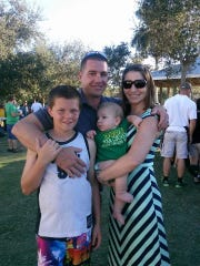 Philip Royer (middle) with his separated wife, Nicole Royer (right), and Royer's two children. Philip Royer died in a fiery crash in St. Lucie County on Friday night, March 1, 2019.