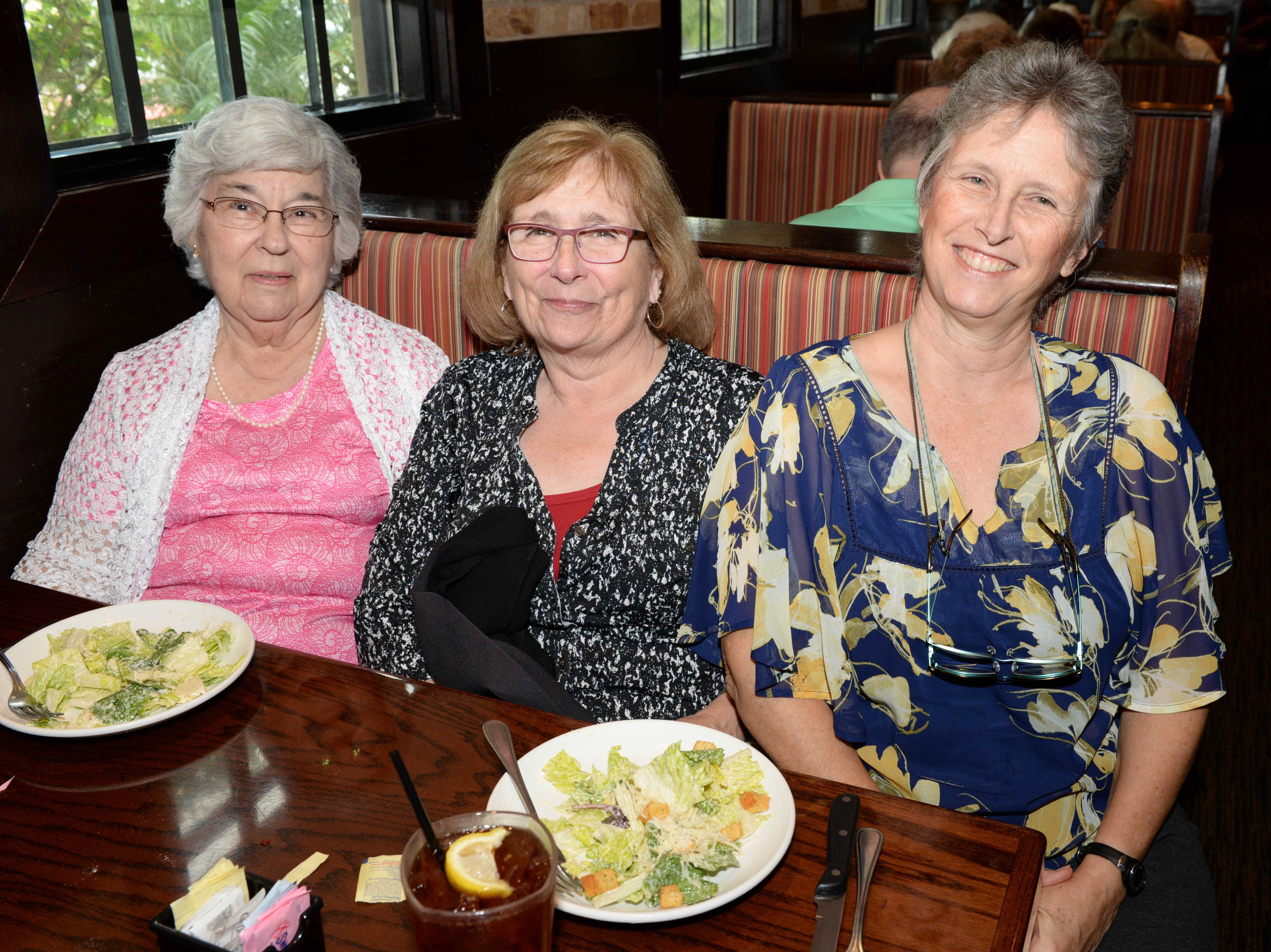 MaryLou Smith, left, Paula Lewis and Jo Moore at Carrabba's Italian Grill in St. Lucie West for the Sarah's Kitchen luncheon.