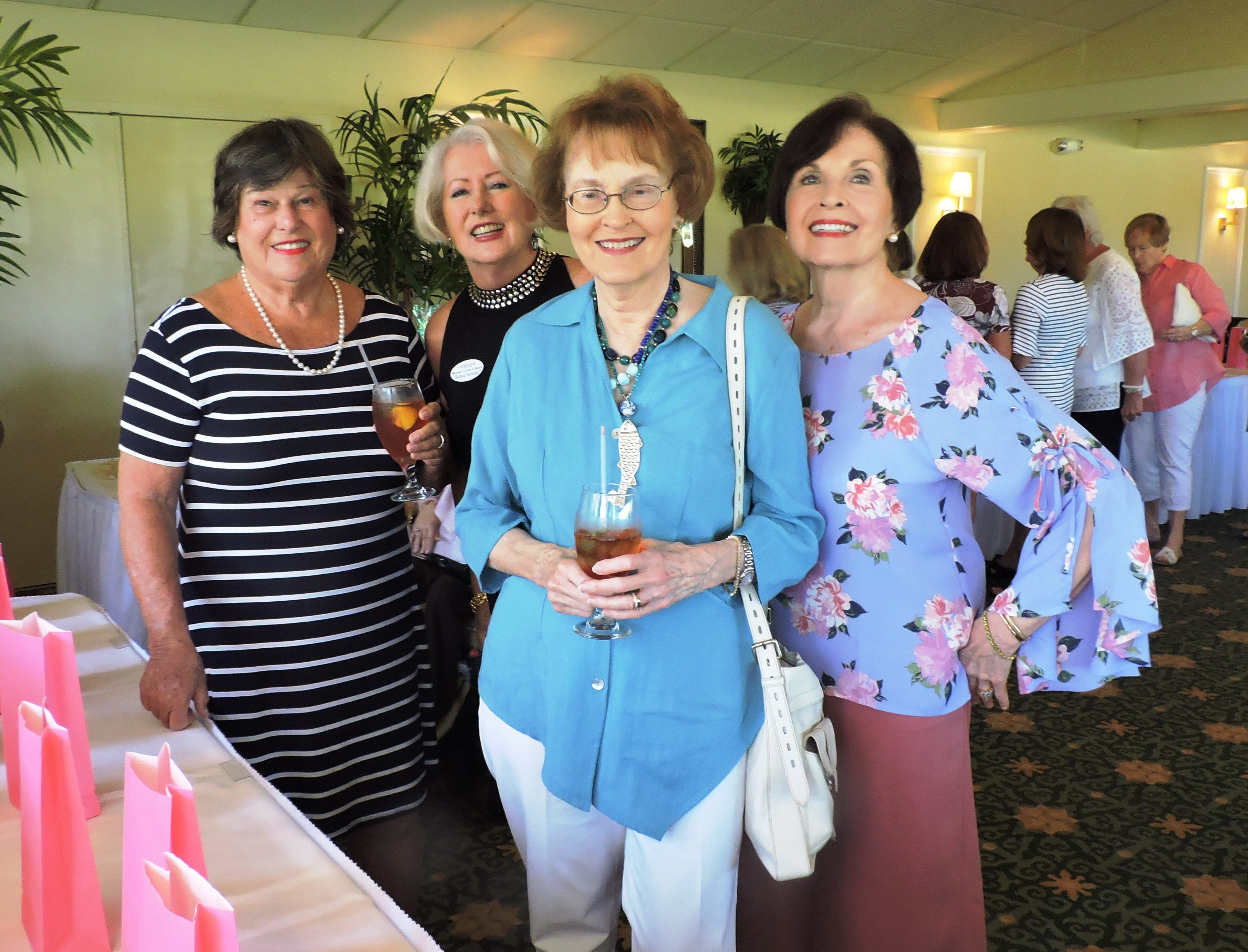 Sandra Wetmore, left, Barbara Scharleau, Judy Mergler and Penny Pagenkopf at Woman's Club of Stuart's annual Food, Friends and Fashion Show.