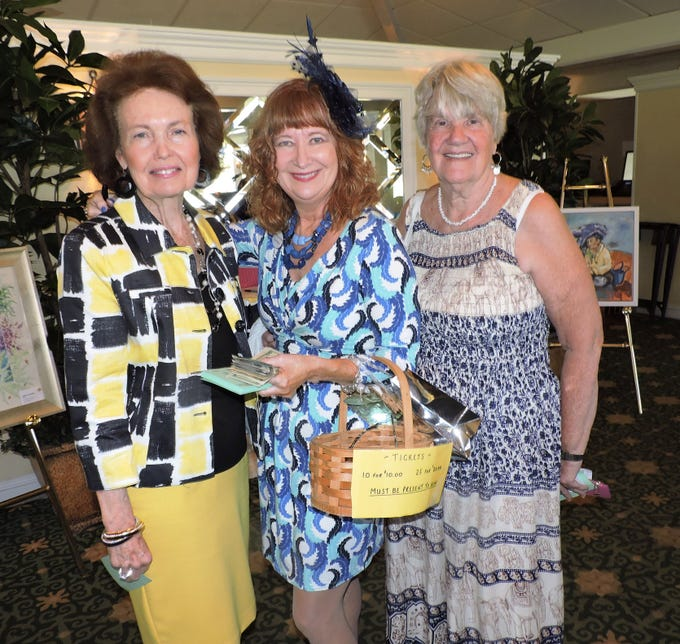 Betty Mulligan, left, Sue Reardon and Loretta Bragg at Woman's Club of Stuart's annual Food, Friends and Fashion Show.