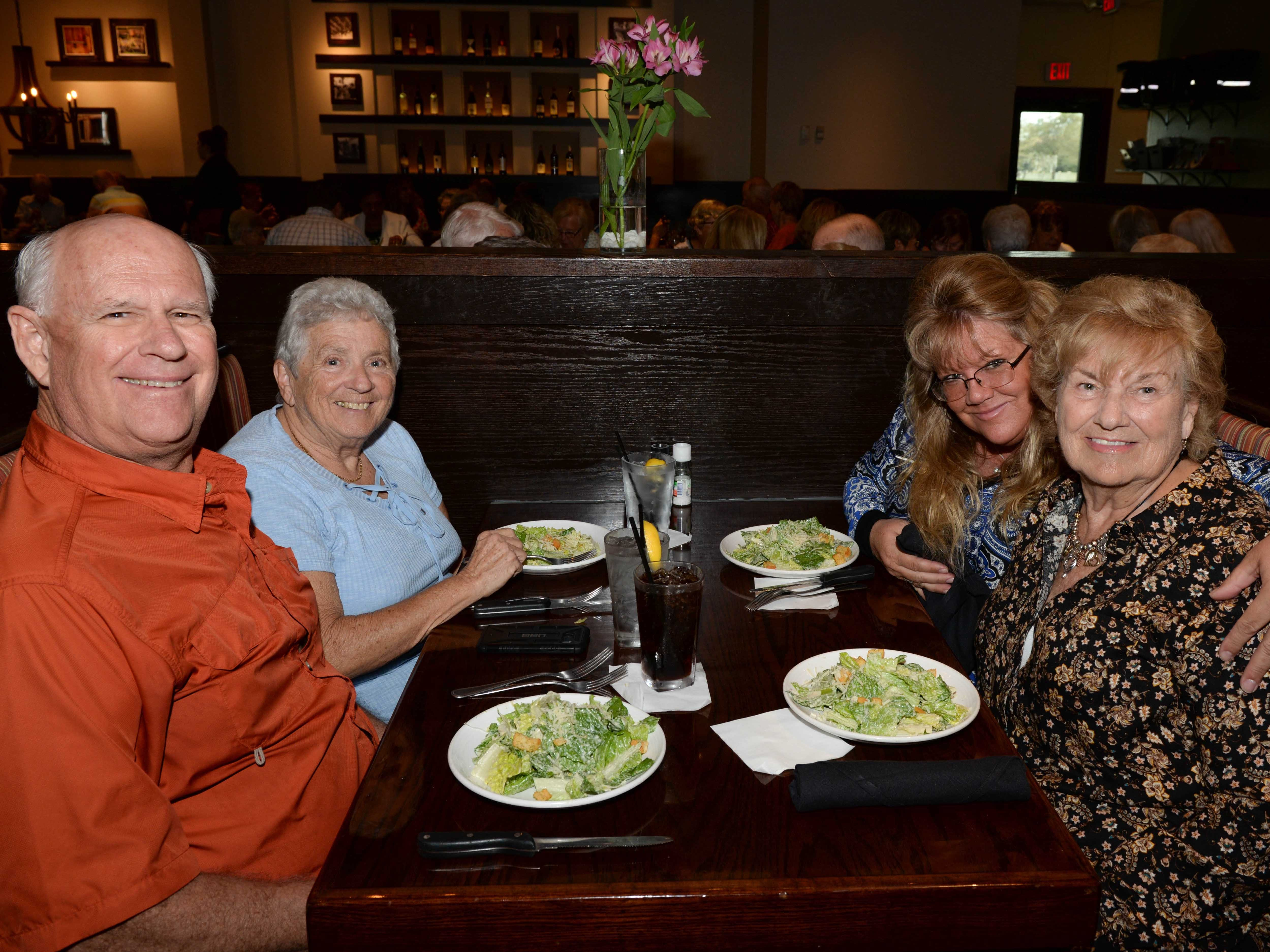 Alan and Brenda Wilson, left, Sue Angarola and Eugenie Weber at Carrabba's Italian Grill in St. Lucie West for the Sarah's Kitchen luncheon.