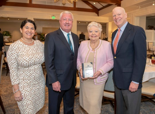 May Smyth, center right, was honored as the 2019 recipient of the Kiplinger Literacy Award, with Knight Kiplinger, editor-in-chief of Kiplinger Publications, right; Stacy Ranieri, president of the Library Foundation of Martin County, left; and Michael Kenny, foundation executive director.