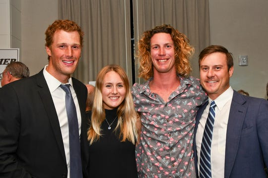 "Jake Hoefler, left, Kelsy Waack, Austin Waclo and Jon Beery of Next Level Watersports attend the ""Salty Dogs and Cat-A-Marans"" Paws & Claws Gala."