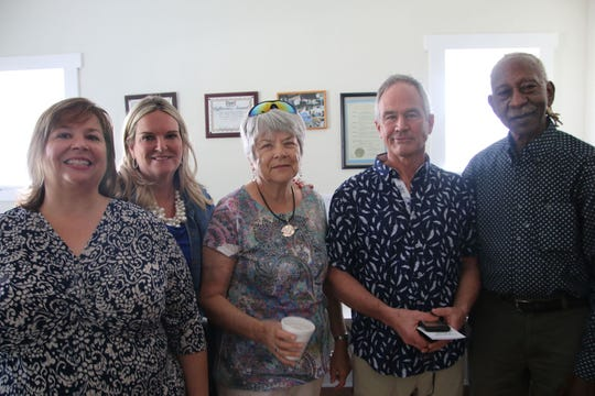 Sandi Creyaufmiller, left, Cathy Townsend, Tom Brennan and George Bussey attend the open house at the new Dorothy Brennan Learning Center in Fort Pierce.