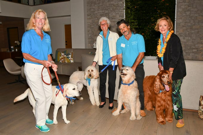 Pet therapy volunteers, from left, Nancy Bowden with Sydney, Brenda Susla with Baxter, Joe Wertheim with Karma, and Christine Apted with Maggie greet guests as they arrive to the Humane Society of the Treasure Coast Paws & Claws Gala at Hutchinson Shores Resort & Spa in Jensen Beach.