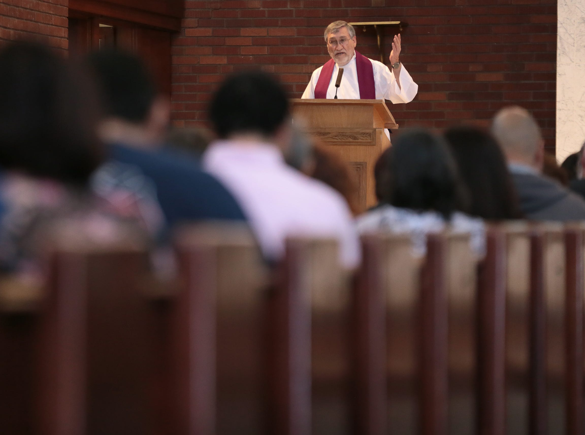 Father Ed Carpenter held several Ash Wednesday services at the central El Paso church. Catholic faithful celebrated Ash Wednesday--the start of the Lenten season.