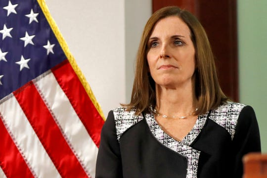 In this Dec. 18, 2018, file photo, then-U.S. Rep. Martha McSally, R-Ariz., waits to speak during a news conference at the Capitol in Phoenix. McSally, now a Republican senator from Arizona, was the first female fighter pilot to fly in combat. She says she was raped in the Air Force by a superior officer.
