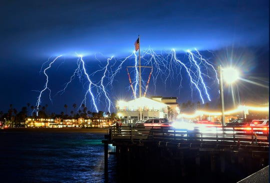 This time exposure photo provided by the Santa Barbara County Fire Department shows a series of lightning strikes over Santa Barbara, Calif., seen from Stearns Wharf on Tuesday evening.