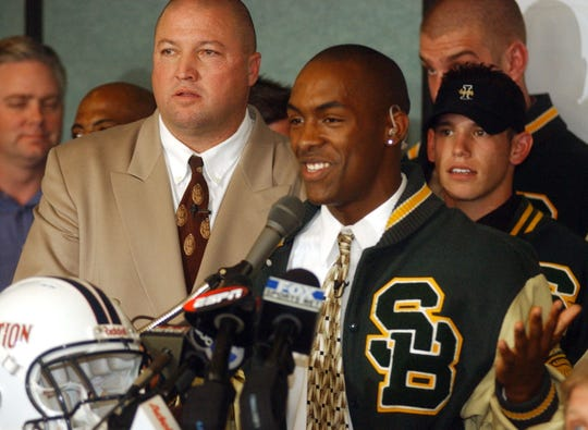 Lorenzo Booker, with St. Bonaventure High head coach Jon Mack to his right, announces live on ESPN his attention to go to Florida State in 2002.