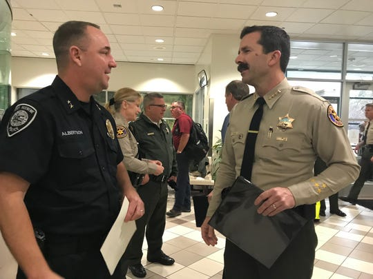 Ventura County Sheriff Bill Ayub, right, greets Port Hueneme Cmdr. Robert Albertson at a groundbreaking ceremony Wednesday for a mental health unit at the Todd Road Jail.