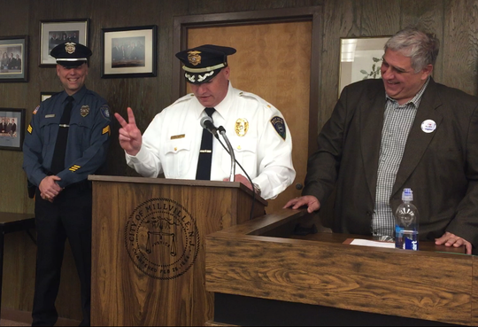 Millville police Chief Jody Farabella (center) jokes while talking about newly promoted Sgt. Richard Kott after a swearing-in ceremony at the City Commission Tuesday night. City Commissioner Joseph Pepitone (right) introduced Kott.