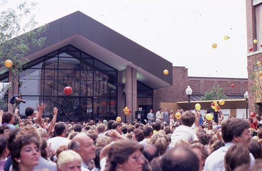 The crowd outside the Wausau Center mall during grand opening celebrations in August 1983. Sally Scinto-Reinertson , who worked on the entertainment committee for the mall opening, said they believed opening the mall with a big bang would bring it success.