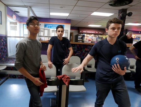 Paul Cirillo, center, a junior at Lakeland High School, left, bowls at Jefferson Valley Lanes in Yorktown March 6, 2019. Cirillo was diagnosed with Hodgkin Lymphoma when he was a freshman. He underwent chemotherapy and radiation therapy and is now cancer free. He will competing in the New York State high school bowling championships in Syracuse this weekend. He was bowling with Nick Perrone of Walter Pants High School and Jacob Portem of Lakeland, who will be both competing in the state tournament.