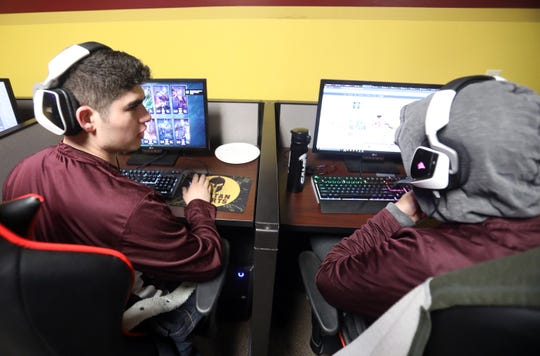 From left, Sophomores Sean Russo and Josh Martinez goes over final logistics before their team competes against Southern New Hampshire in League of Legends eSports competition at St. Thomas Aquinas March 1, 2019.