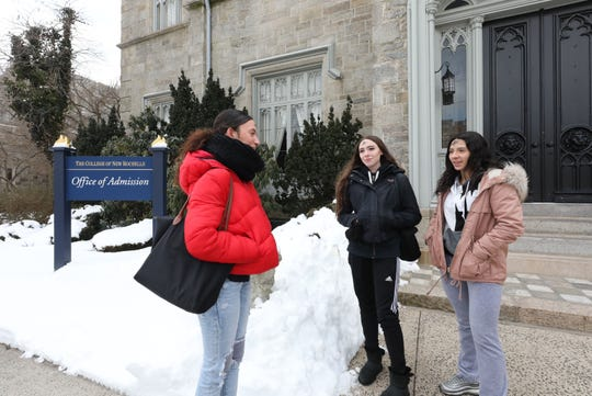 Briana DeSanto, Brianna Mueller and Briana Tavarez, students at the College of New Rochelle, chat about the school closing, after attending Ash Wednesday Mass at the campus, March 6, 2019.