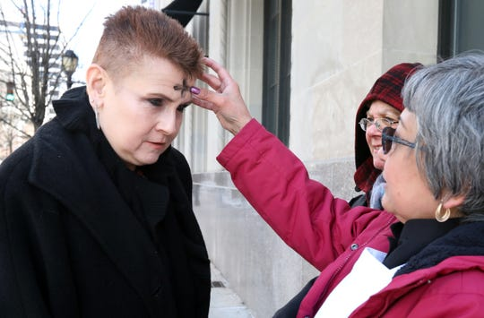"Rev. Martha Cruz of St. Matthew's Lutheran Church in White Plains administers ashes to Deborah Flynn of Mahopac for Ash Wednesday in downtown White Plains March 6, 2019. Rev. Cruz, along with Deacon Carol Nestor, provided an ""Ashes on the Go"" and prayer service to the community in downtown White Plains."
