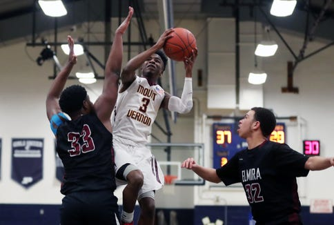 Mt. Vernon's Charles Lovett (3) goes up for a shot in front of Elmira's Markel Jenkins (33) during a boys regional playoff game at Poughkeepsie High School March 5, 2019. Mt. Vernon won the game 71-55.