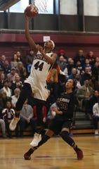 Aubrey Griffin of Ossining shoots over Zaria DeMember-Shazer of Elmira during a a Class AA girls basketball regional semifinal at Ossining High School on Tuesday. Ossining defeated Elmira 98-58.