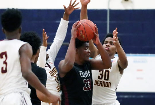 Mt. Vernon's Nigel Harris (15) and Troy Hupstead (30) put pressure on Elmira's Markel Jenkins (33) during a boys state regional playoff game at Poughkeepsie High School on Tuesday.