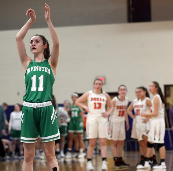 Irvington's Abby Conklin (11) shoots a free throw after the Marlboro's coach Marion Appler got a technical foul during girls basketball regional semifinals at Mount Saint Mary College in Newburgh March 5, 2019.   Irvington defeats Marlboro 66-50.