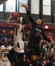 Aubrey Griffin of Ossining shoots over Zaria DeMember-Shazer of Elmira during a a Class AA girls basketball regional semifinal at Ossining High School on Tuesday. Ossining defeated Elmira 98-58.