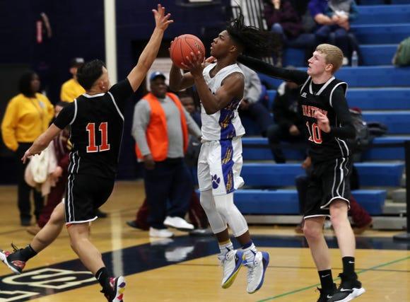 MLK's Romello Fasion (1) drives to the basket against Marathon during the boys regional at Poughkeepsie High School March 5, 2019. Marathon won the game 70-60.