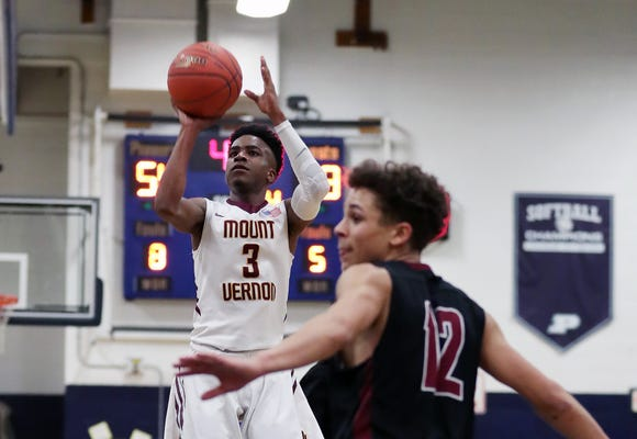Mt. Vernon's Charles Lovett (3) puts up for a shot in front of Elmira's Jaycee Cade (12) during a boys regional playoff game at Poughkeepsie High School March 5, 2019. Mt. Vernon won the game 71-55.