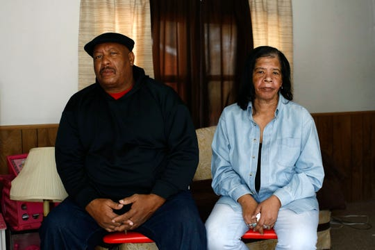 In this Jan. 28, 2019, photo, Antone Black, left, and his wife, Jennell, pose for a photograph after an interview with The Associated Press in their home in Greensboro, Md. Their son Anton Black, 19, died after a struggle with three officers and a civilian outside the home in September 2018. (AP Photo/Patrick Semansky)